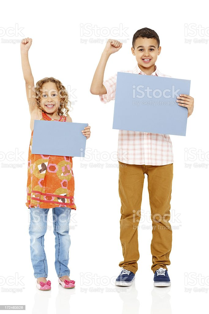 Excited little kids displaying empty billboard royalty-free stock photo