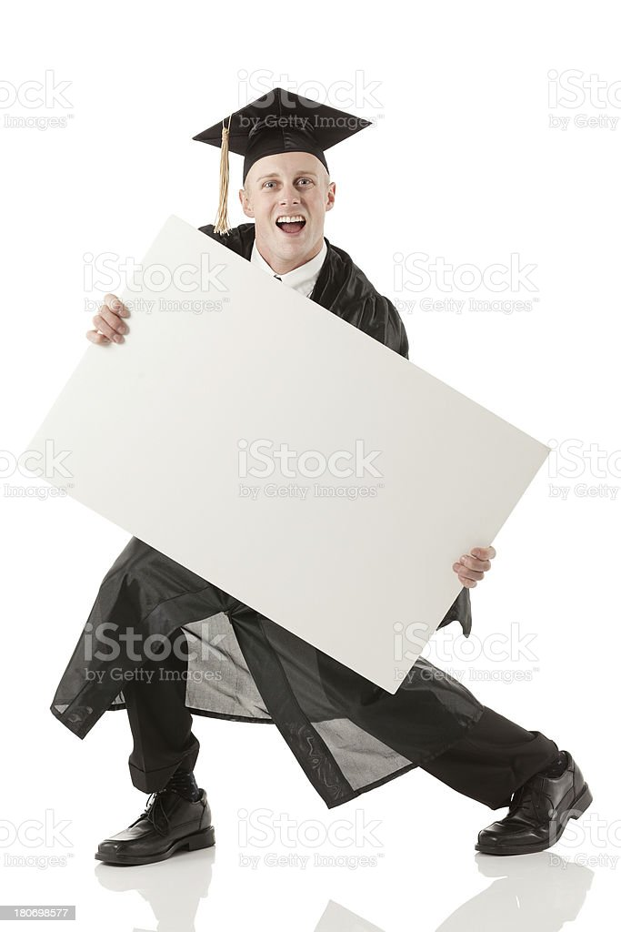 Excited male graduate holding a whiteboard royalty-free stock photo