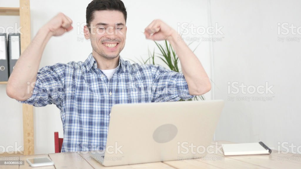 Excited Man Celebrating Success and Achievement at Work