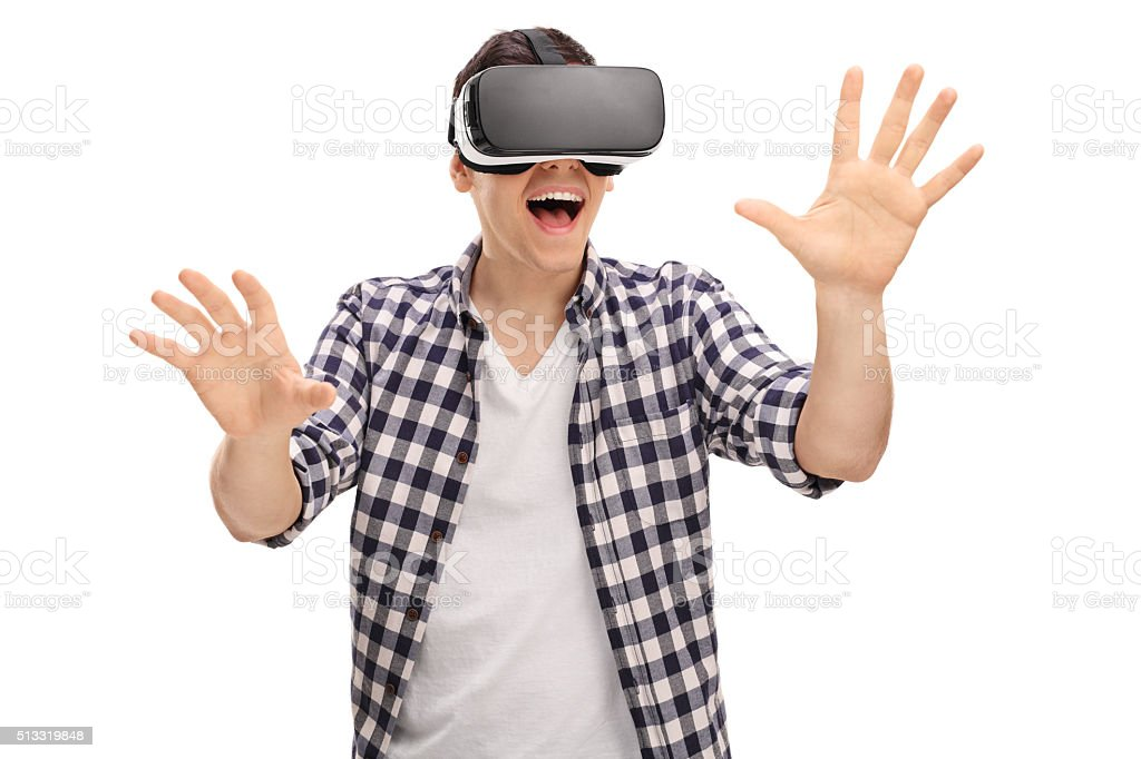 Excited man experiencing virtual reality stock photo