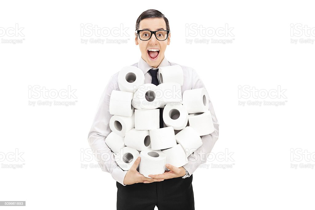Excited man holding a pile of toilet paper stock photo