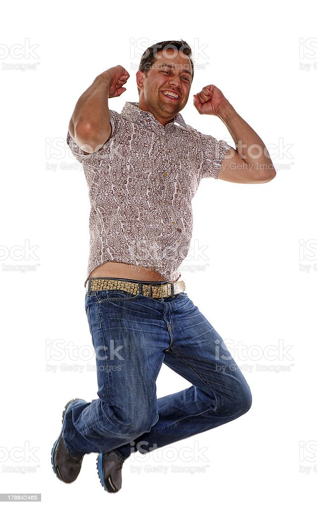 Excited man jumping in the air royalty-free stock photo