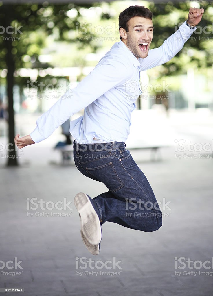 Excited man jumping royalty-free stock photo
