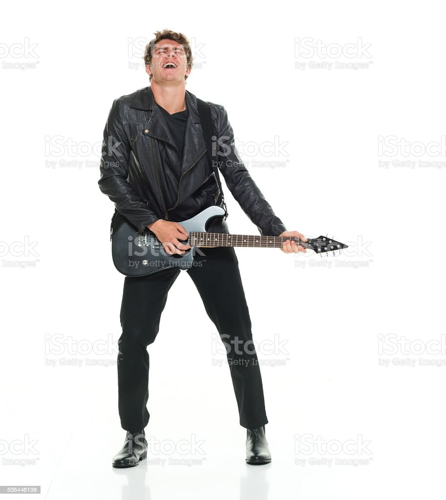 Excited man playing guitar stock photo