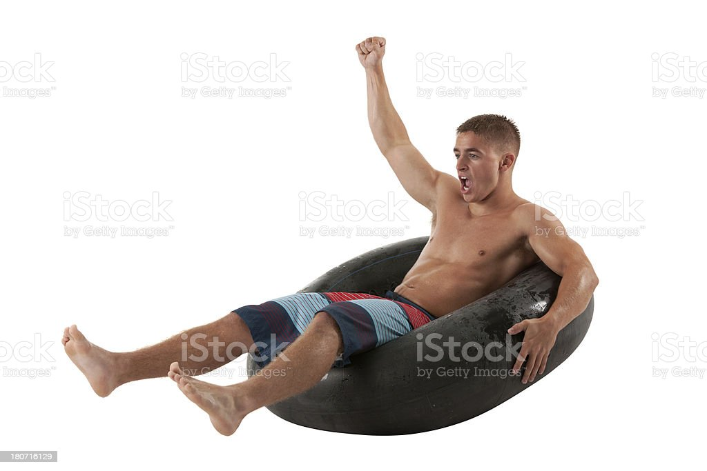 Excited man reclining in an inner tube royalty-free stock photo