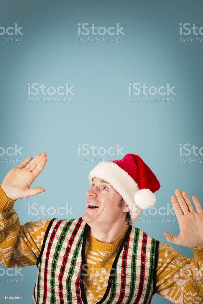 Excited Man Wearing Santa Hat and Ready to Party royalty-free stock photo