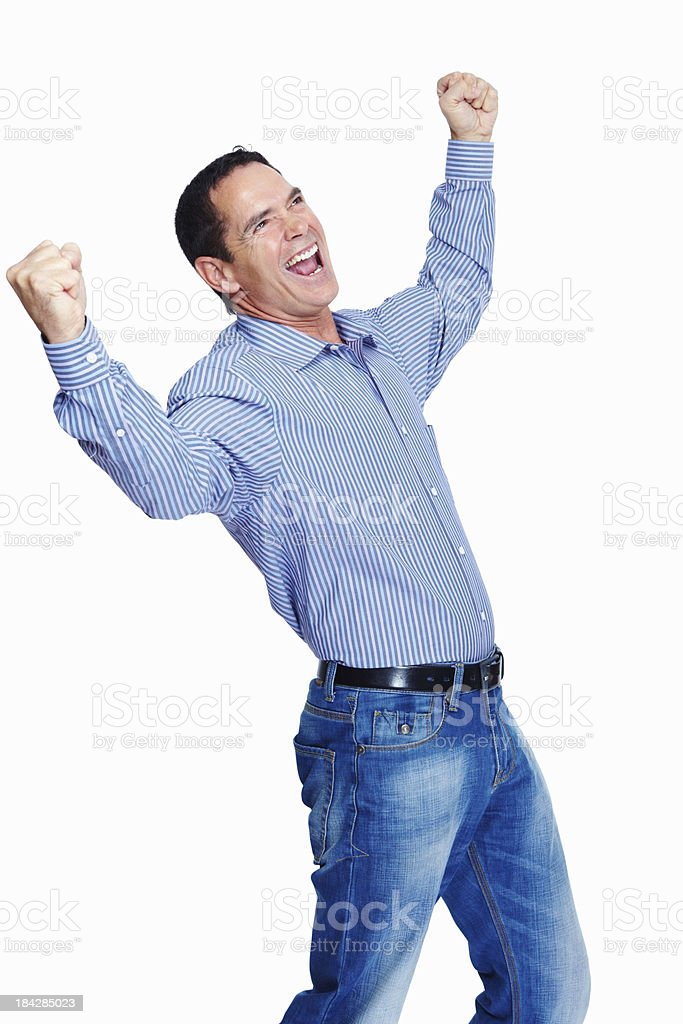 Excited mature man celebrating with arms outstretched royalty-free stock photo