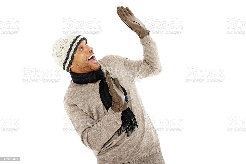 Excited mature man in warm clothes looking away royalty-free stock photo