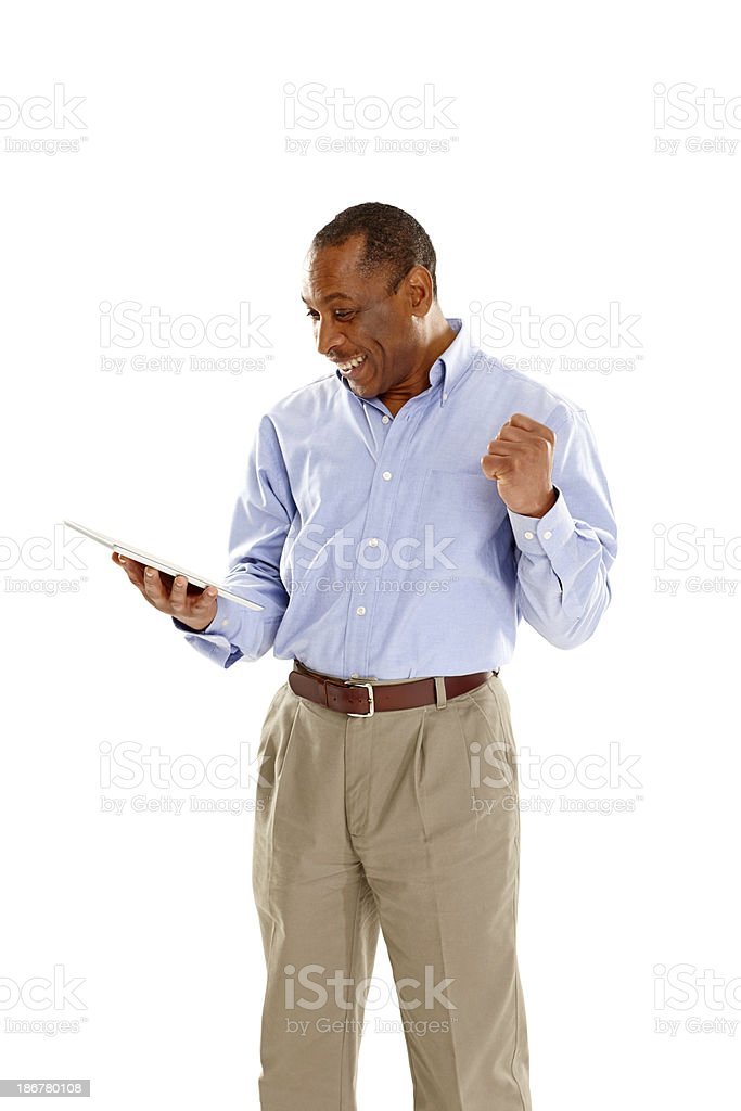 Excited mature man with digital tablet royalty-free stock photo