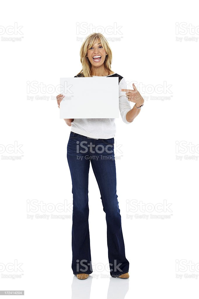 Excited mature woman showing blank sign board royalty-free stock photo