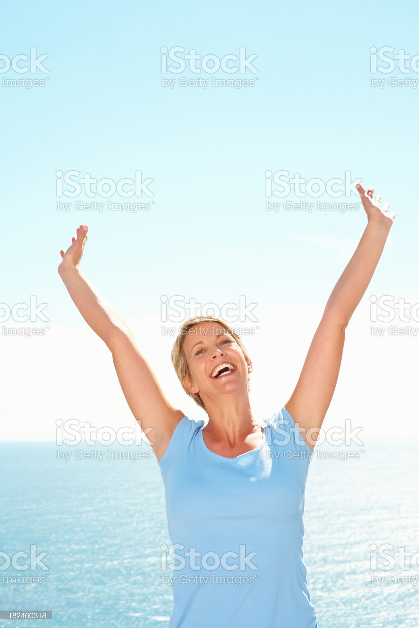 Excited mid adult woman cheering royalty-free stock photo