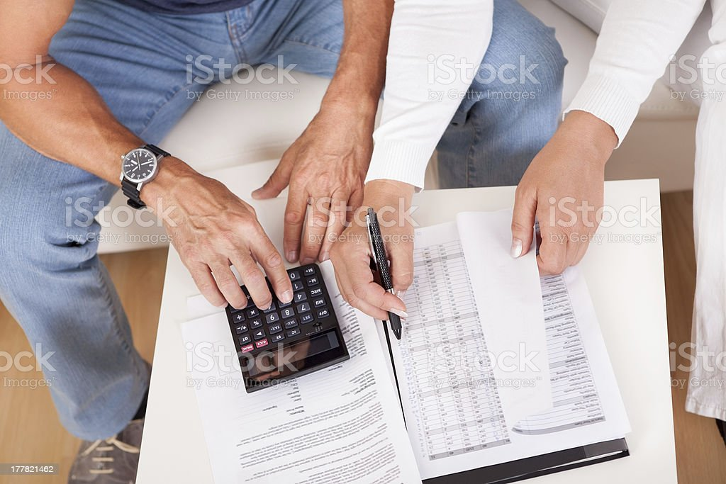 Excited middle-aged couple doing finances at home royalty-free stock photo