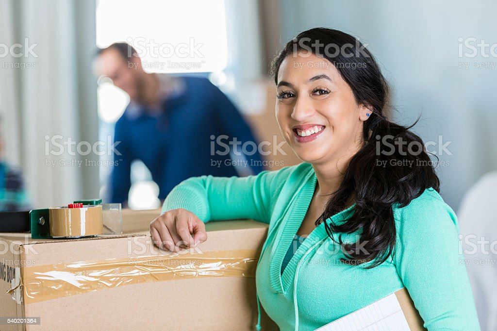 Excited mom preparing to move to new home stock photo