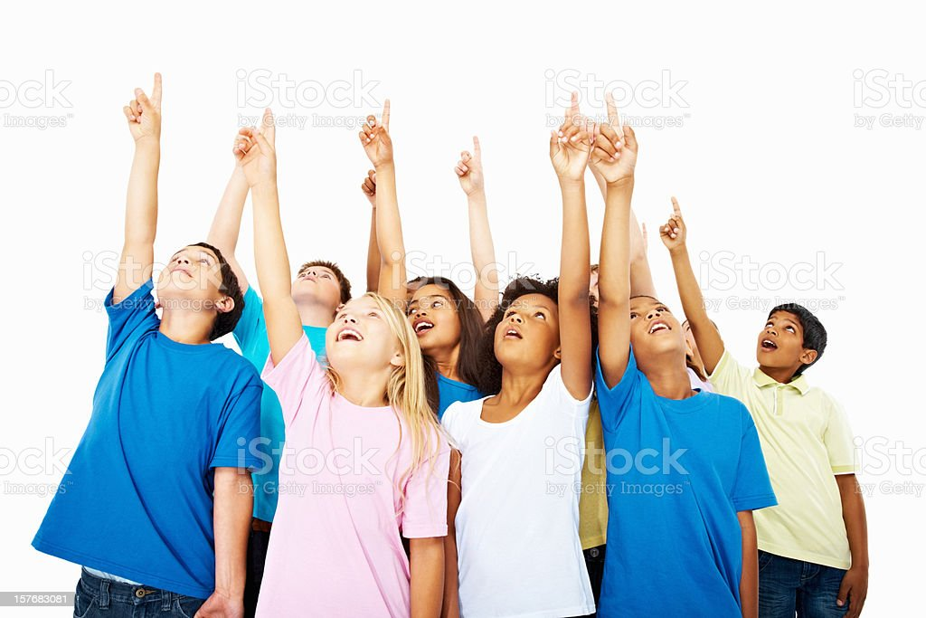 Excited multi ethnic kids points up against white background royalty-free stock photo