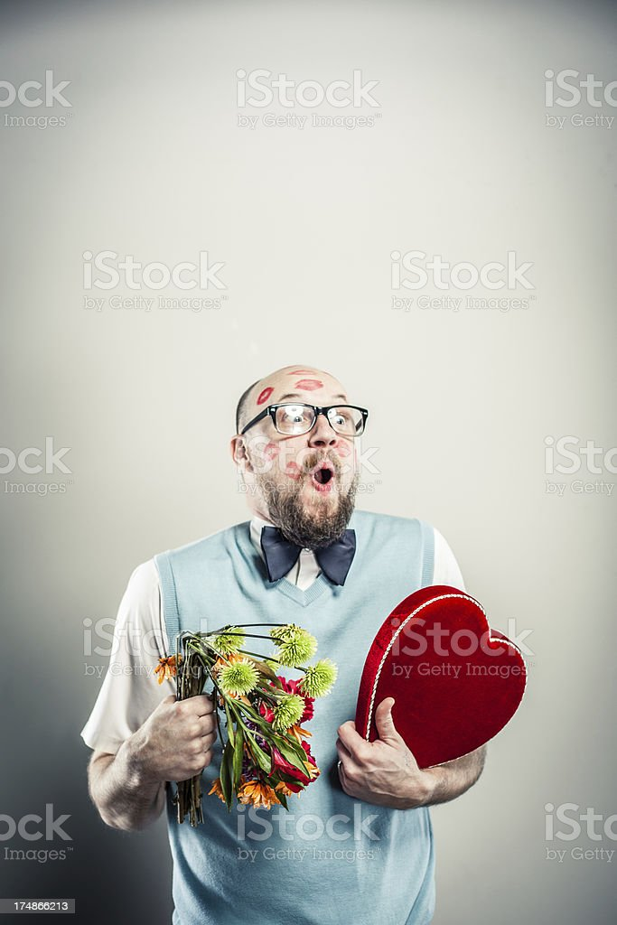 Excited Nerdy Man holding Valentine Flowers and Heart royalty-free stock photo
