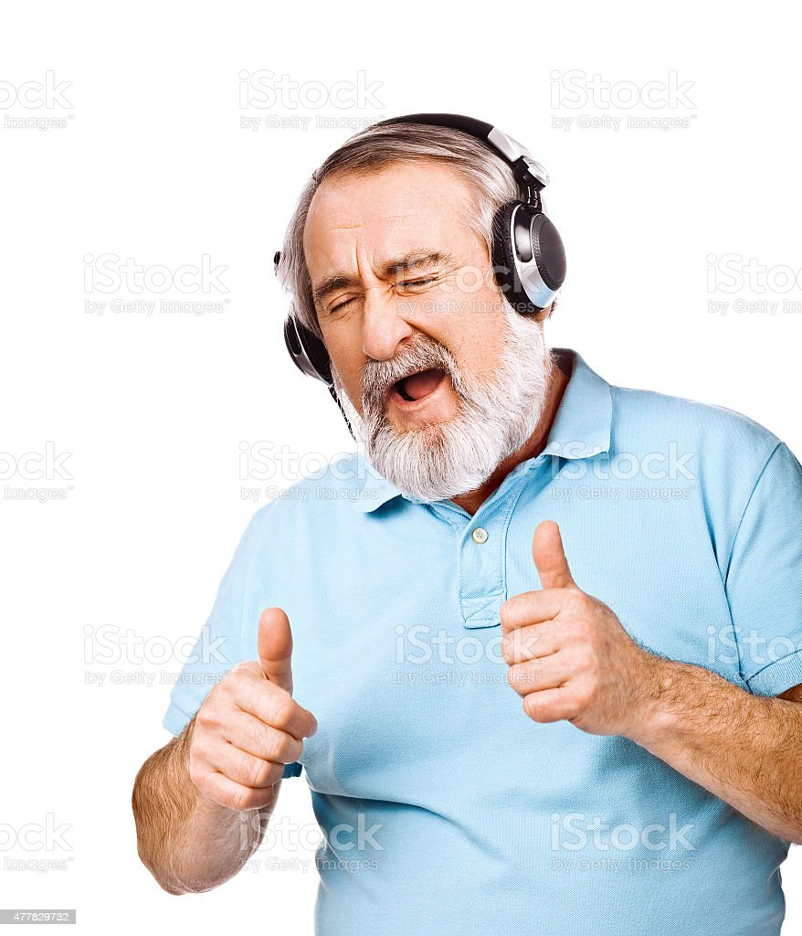 Excited old man listening to music stock photo