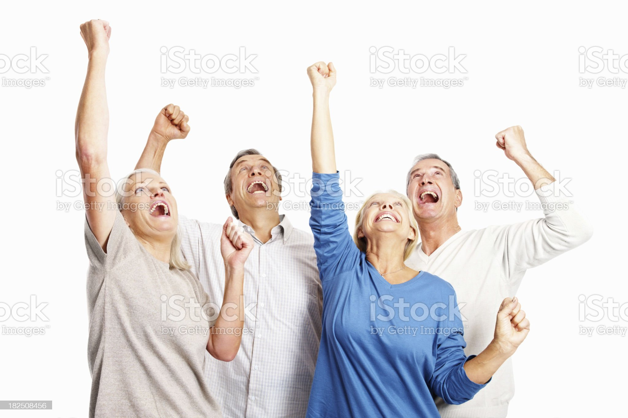 Excited old people raising hands in joy over white royalty-free stock photo