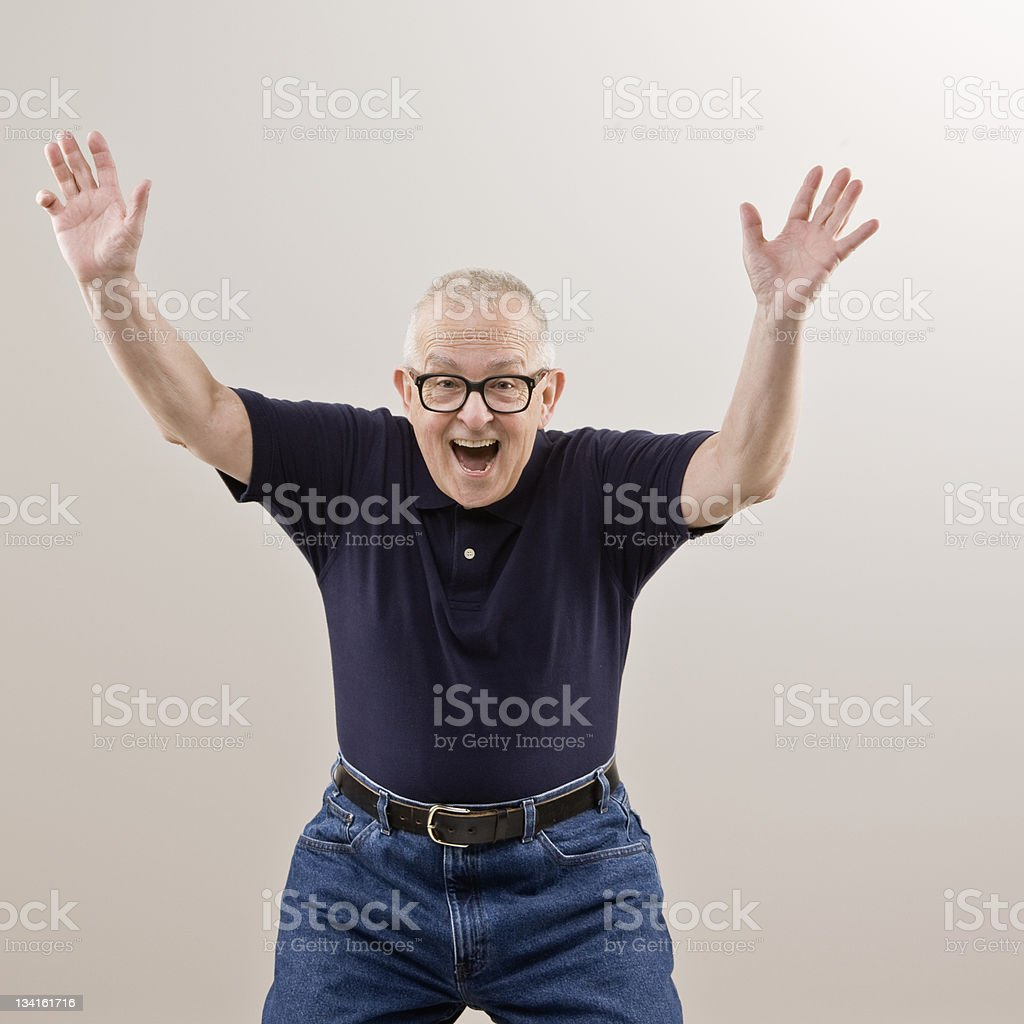 Excited older man cheering and celebrating his success royalty-free stock photo