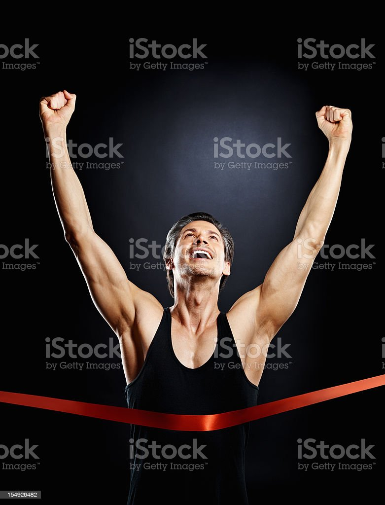 Excited runner finishing first place stock photo