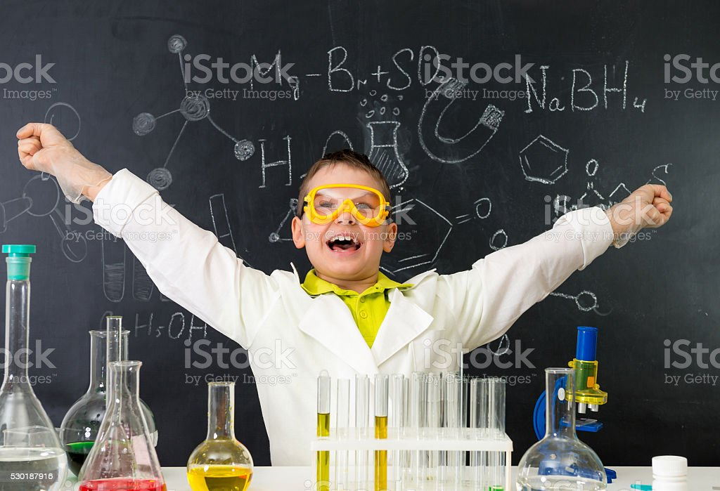 excited schoolboy in chemistry lab made a discovery stock photo