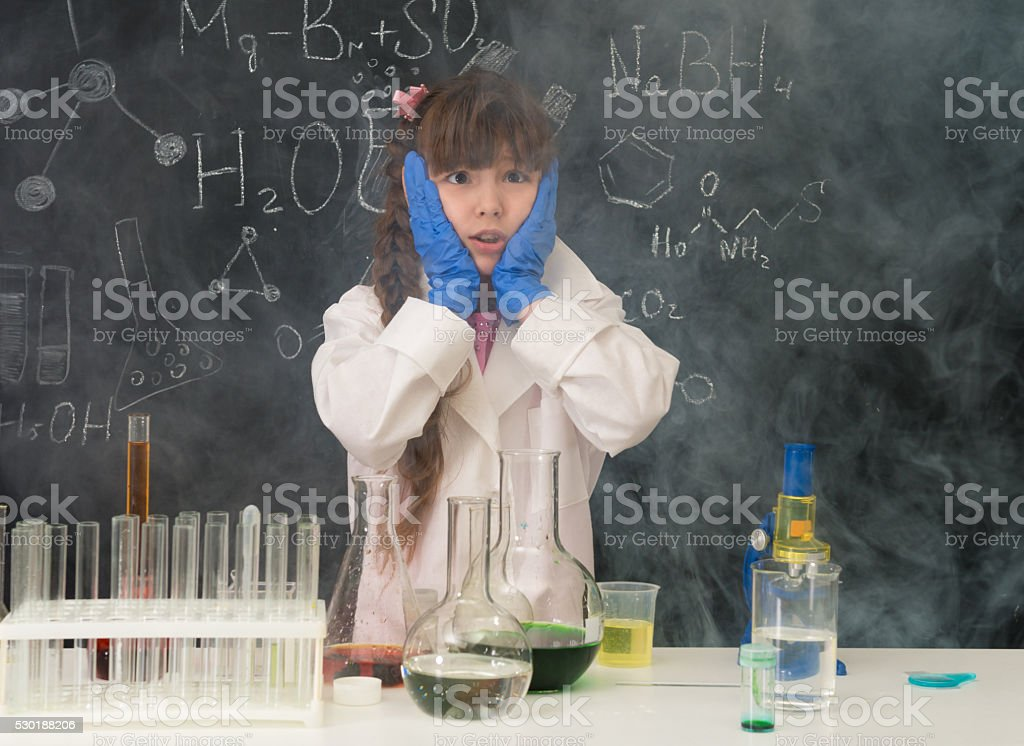 excited schoolgirl in fume after chemical experiment stock photo