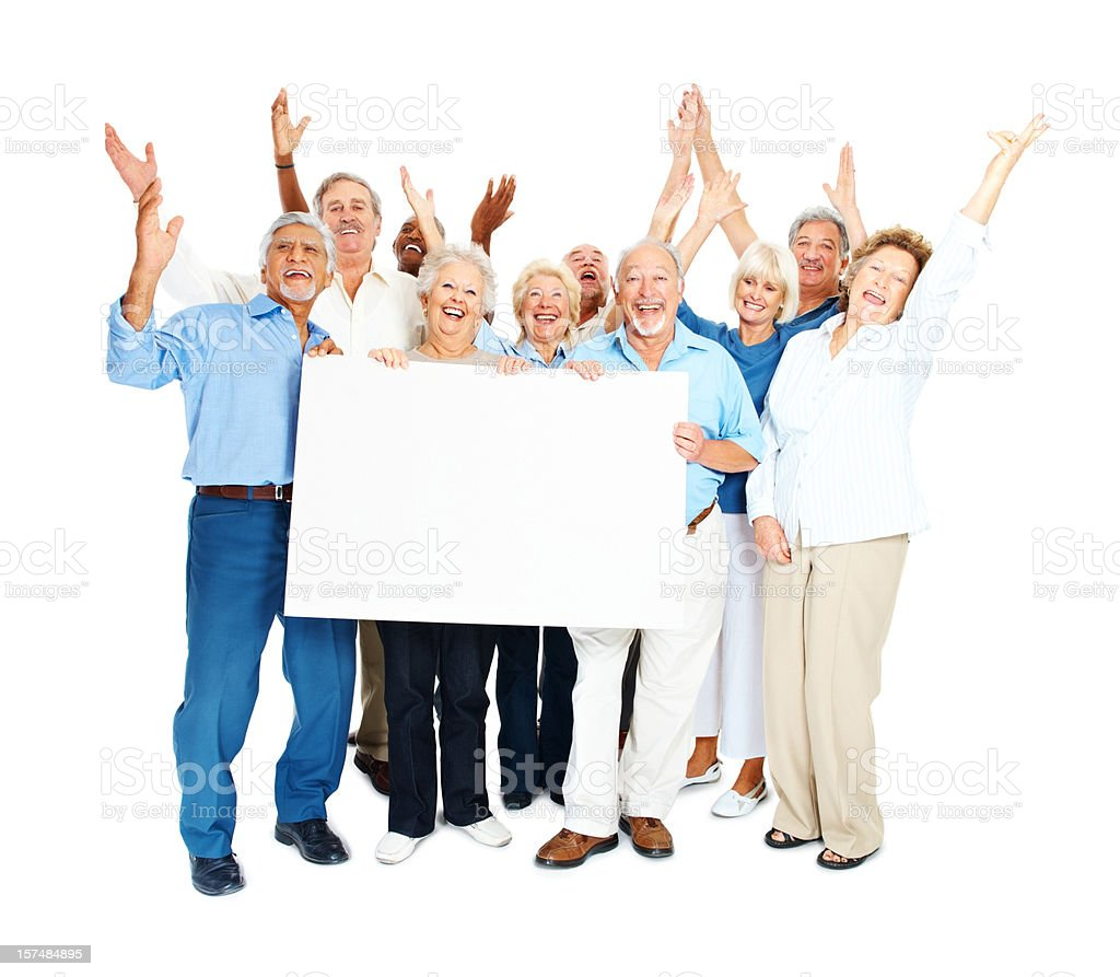 Excited senior citizens with blank placard over white royalty-free stock photo