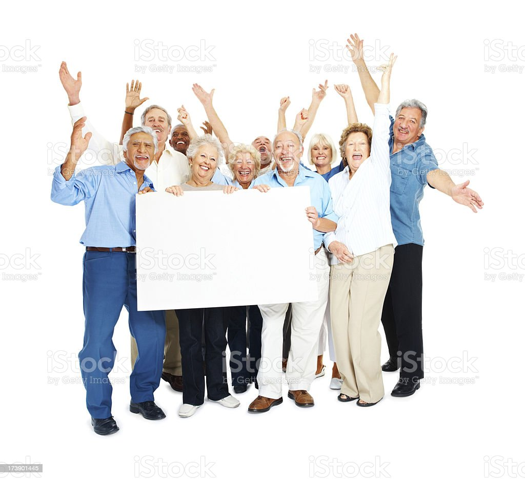 Excited senior men and women holding placard royalty-free stock photo