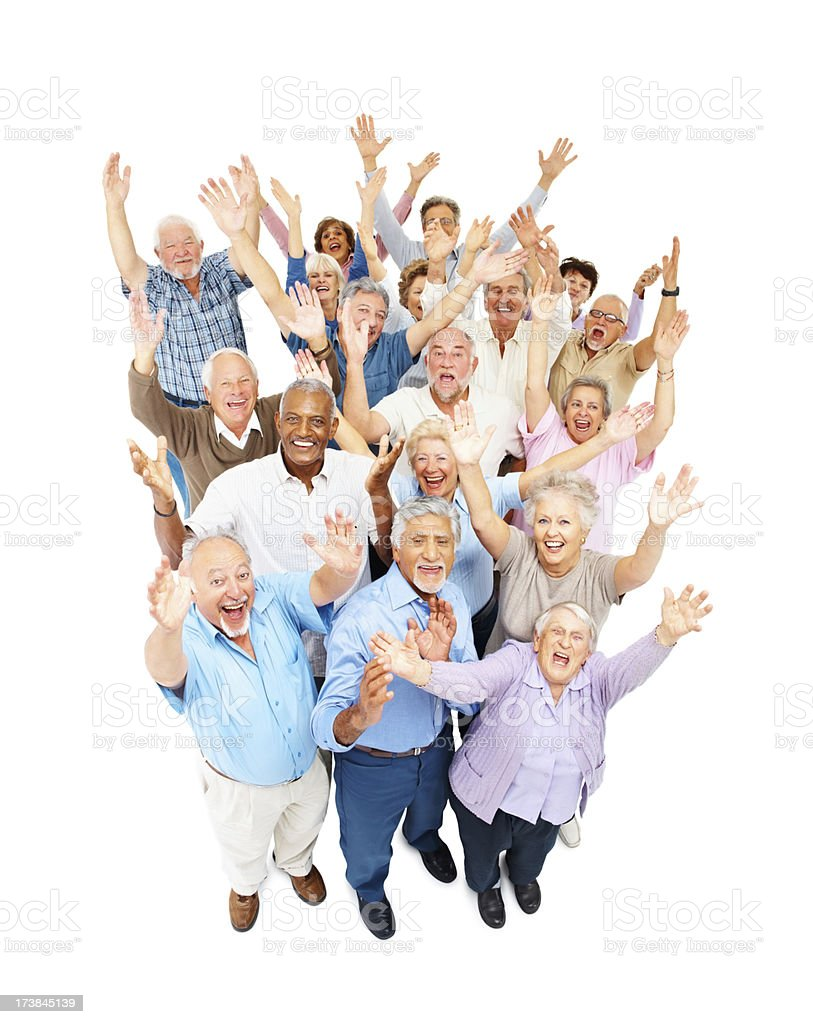 Excited senior men and women standing together royalty-free stock photo