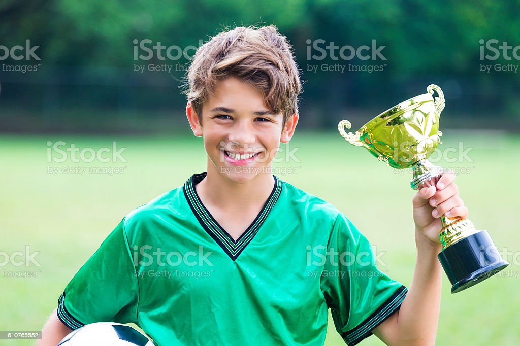 Excited soccer champ with trophy stock photo