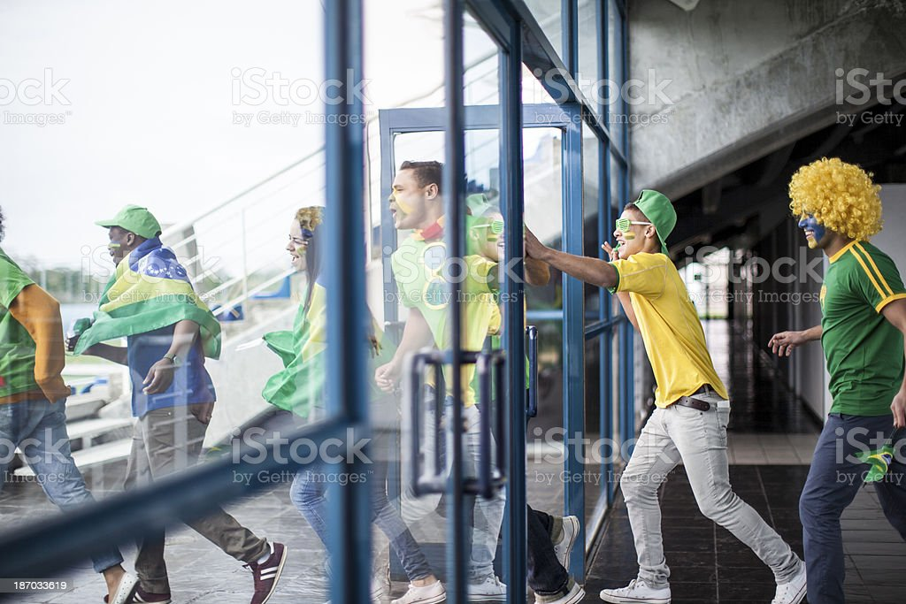 Excited soccer fans cheering stock photo
