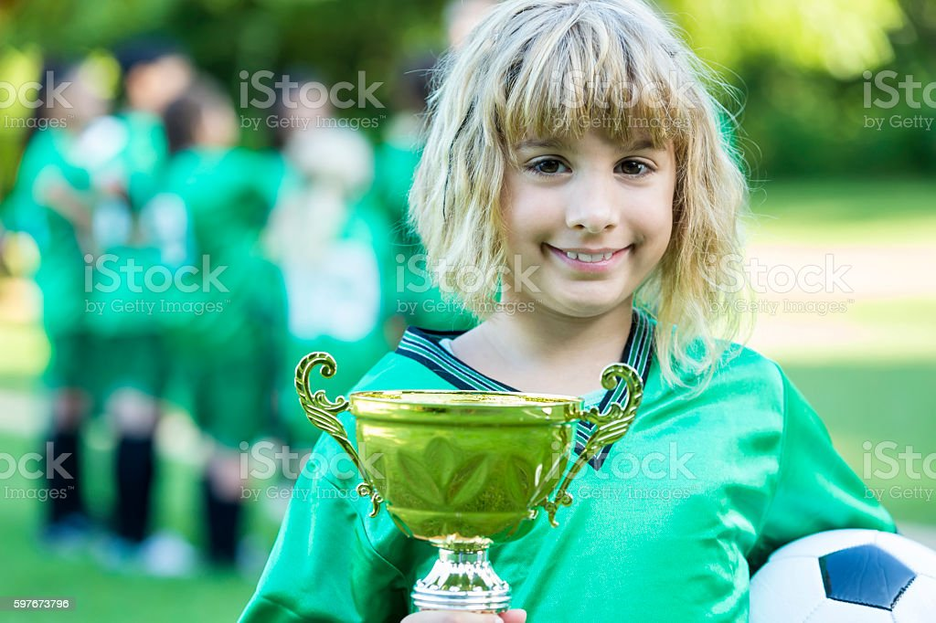 Excited soccer player with award after game stock photo