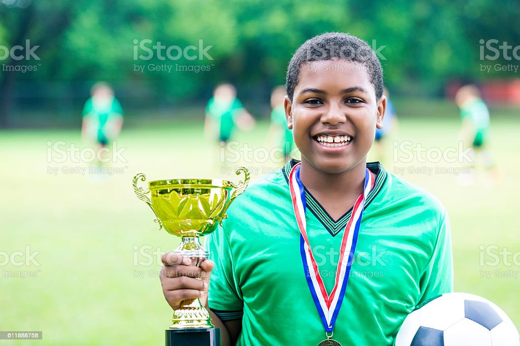 Excited soccer tournament champion stock photo