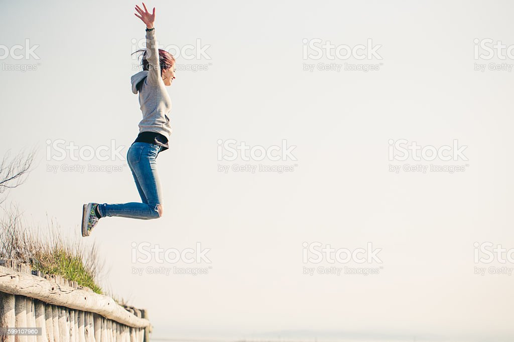 Excited Teenager jumping stock photo