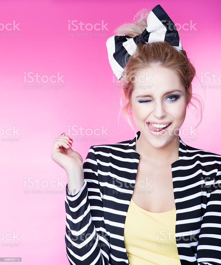 Excited winking young attractive woman stock photo