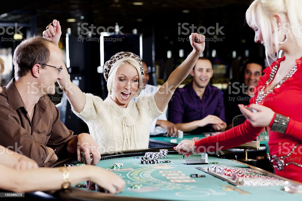 Excited winner at the blackjack table stock photo