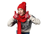Excited winter warm clothing girl giving double thumb up