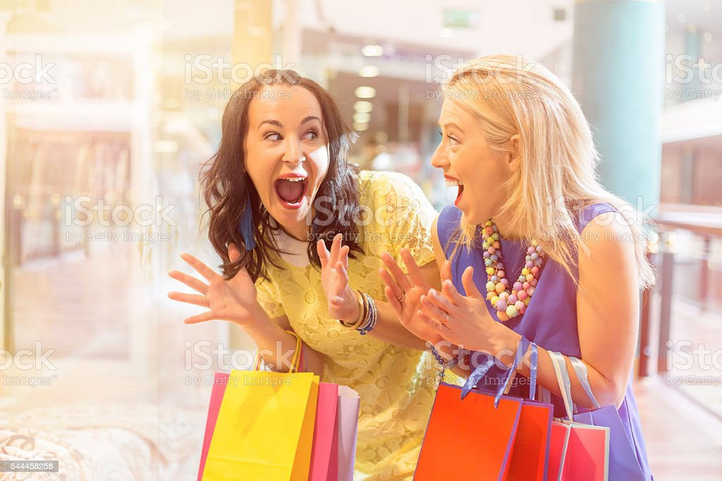 Excited woman about the ongoing sale stock photo