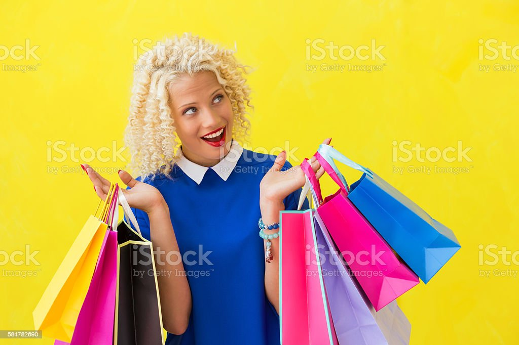 Excited woman after shopping stock photo