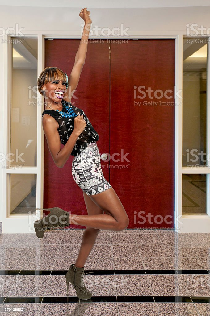 Excited woman celebrating stock photo