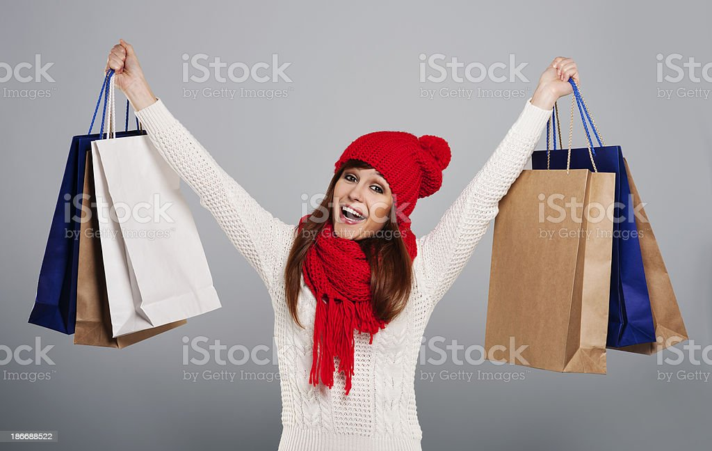 Excited woman holding a lot of shopping bag royalty-free stock photo