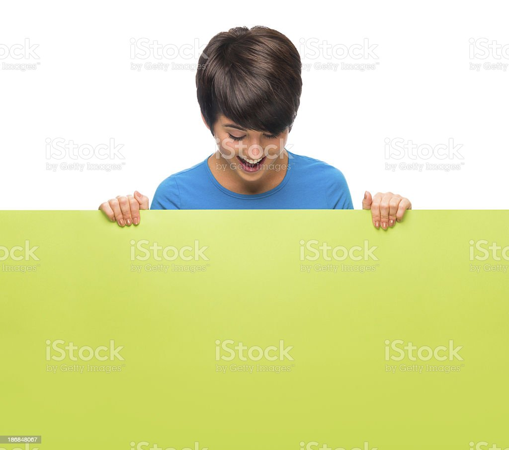 Excited woman looking at a sign royalty-free stock photo