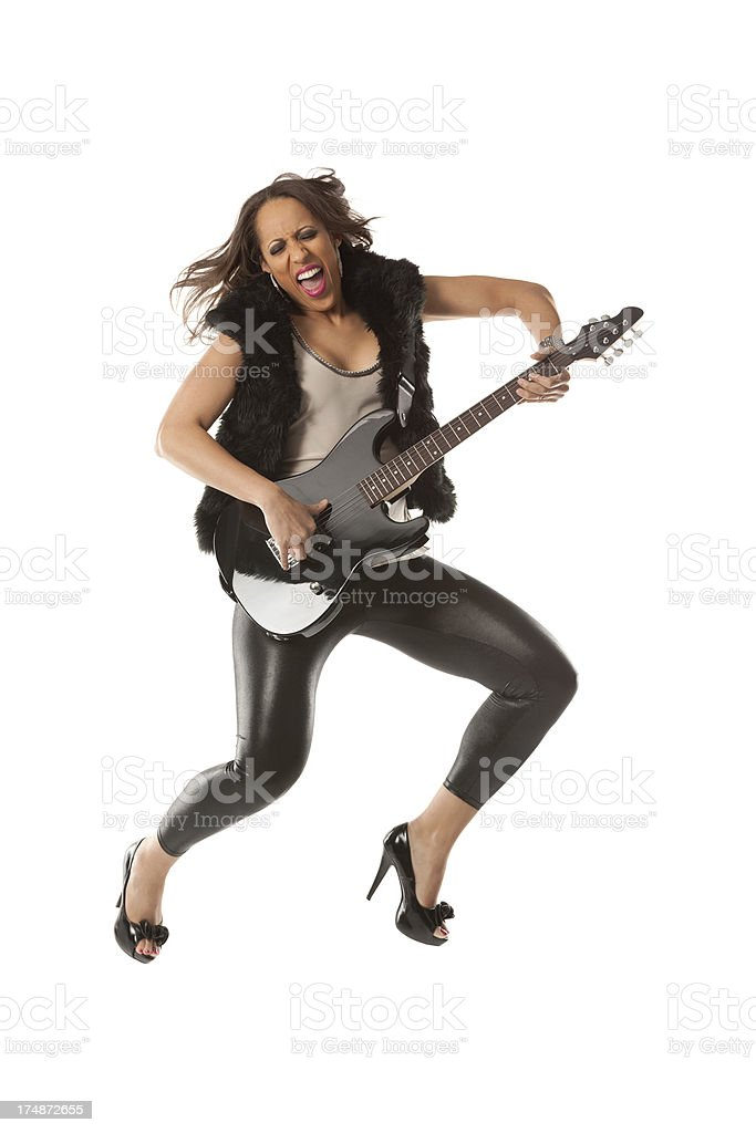 Excited woman playing a guitar royalty-free stock photo