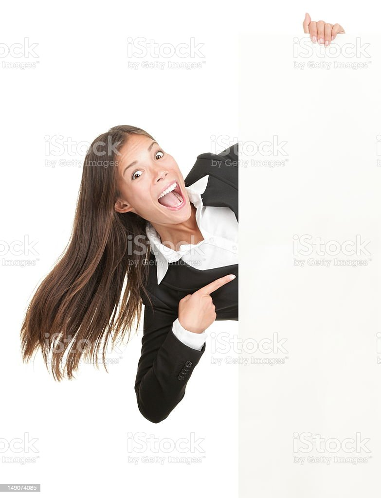 Excited woman pointing at sign royalty-free stock photo