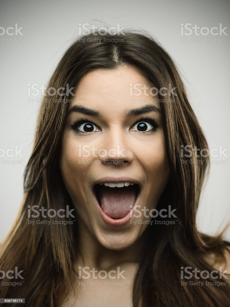 Excited woman screaming against gray background stock photo