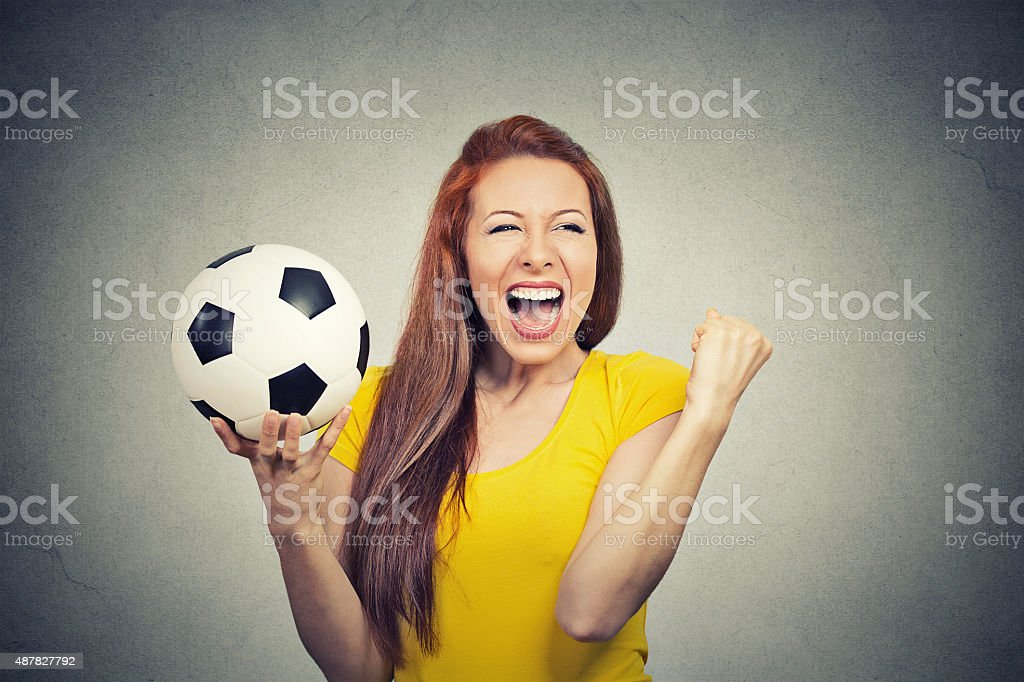 excited woman screaming celebrating team success holding football stock photo