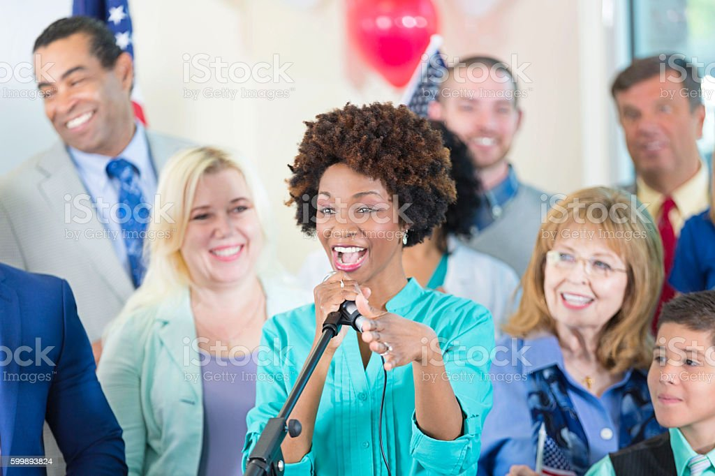 Excited woman speaking at political rally, supporting candidate stock photo