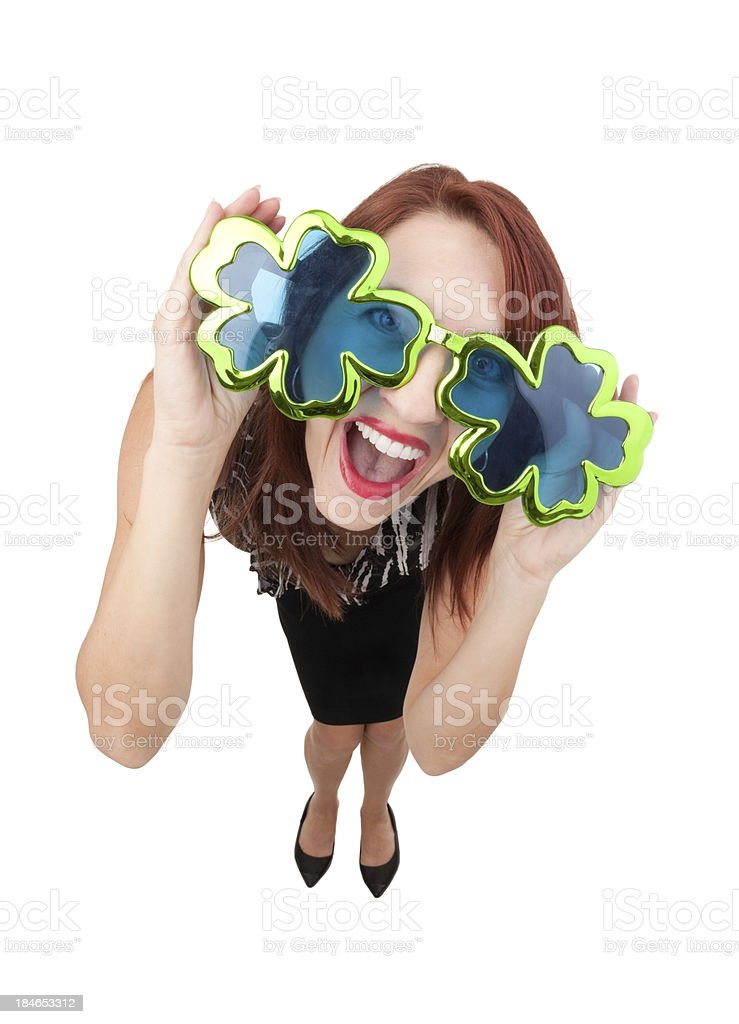 Excited Woman Wearing Shamrock Glasses royalty-free stock photo