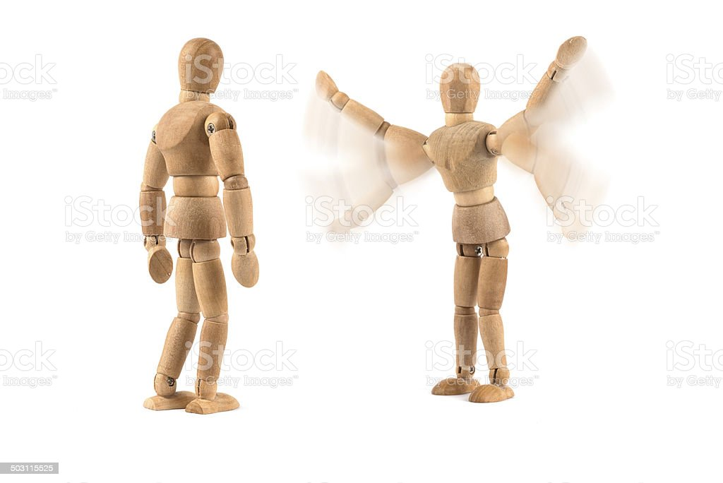 excited wooden mannequin stock photo