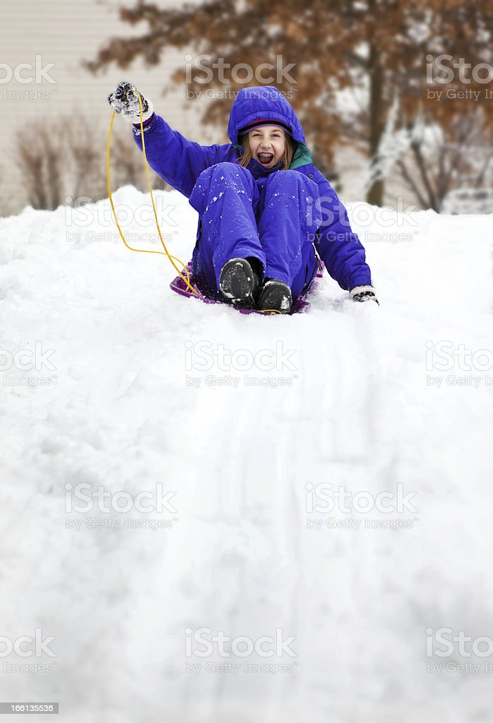 Excited Youg Girl Riding Sled royalty-free stock photo