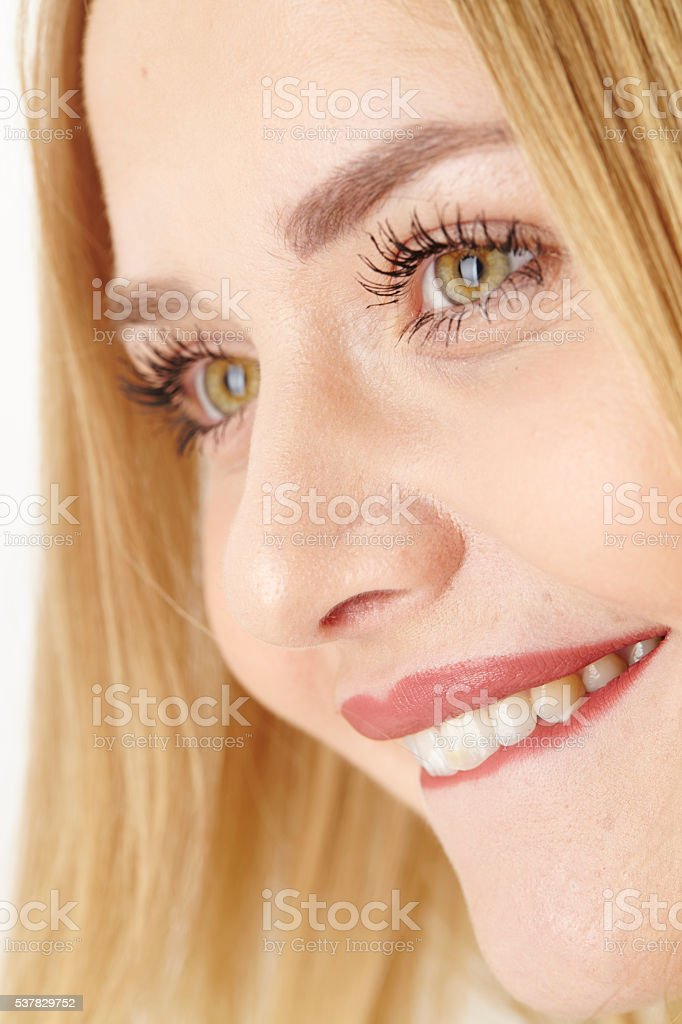 Excited young attractive woman bites on her lip stock photo